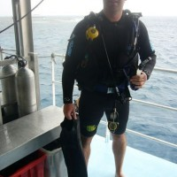 Cal about to jump overboard for one of his certifed dives aboard the majestic Ocean Quest overnight